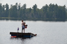 Lucas throwing Shauna into the River.