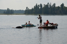 Phillip shooting Stephanie L in the water. Steven and Milo on the dock. Lucas and Abby in the paddle boat.