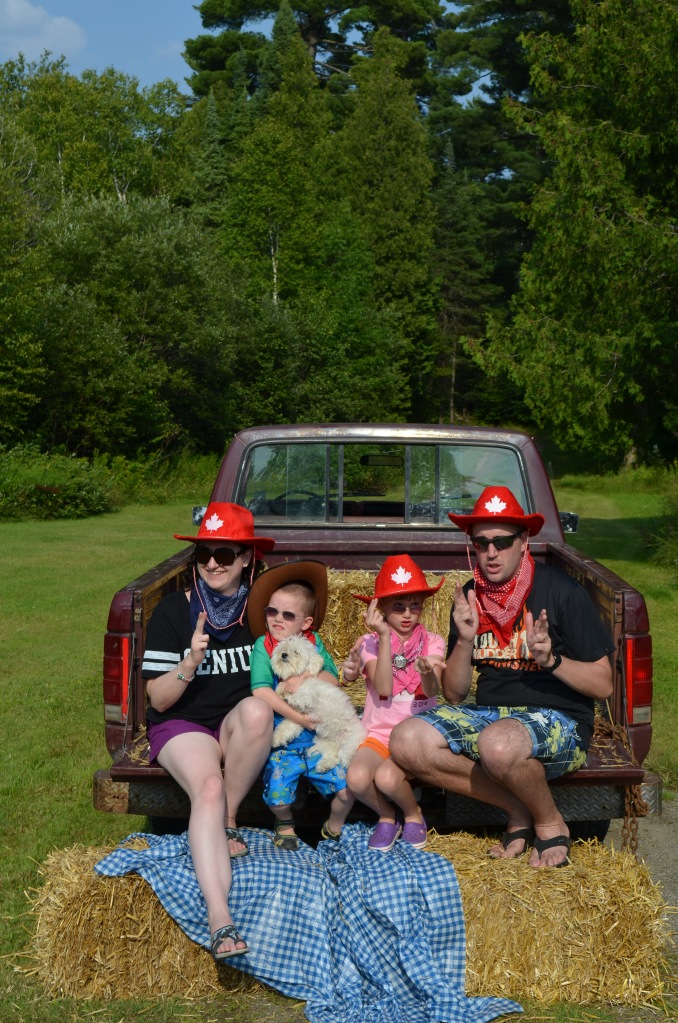 Family Portrait on the back of Philip's truck. Melissa, Aiden, Abby and Peter with the Gagne's dog shooting up the saloon :)