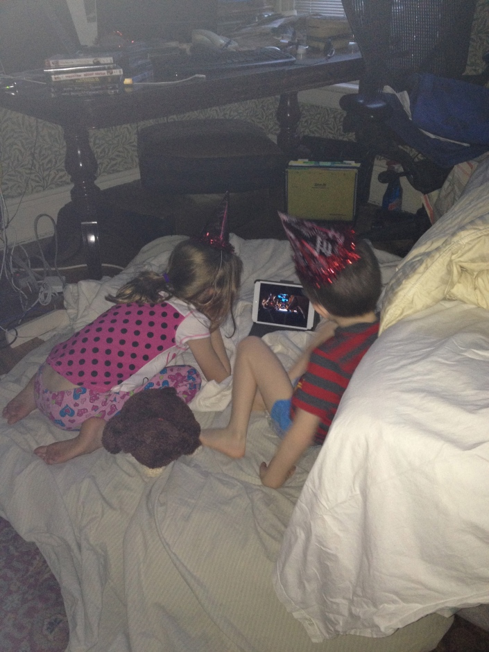 The kids watching a movie on New Year's Morning