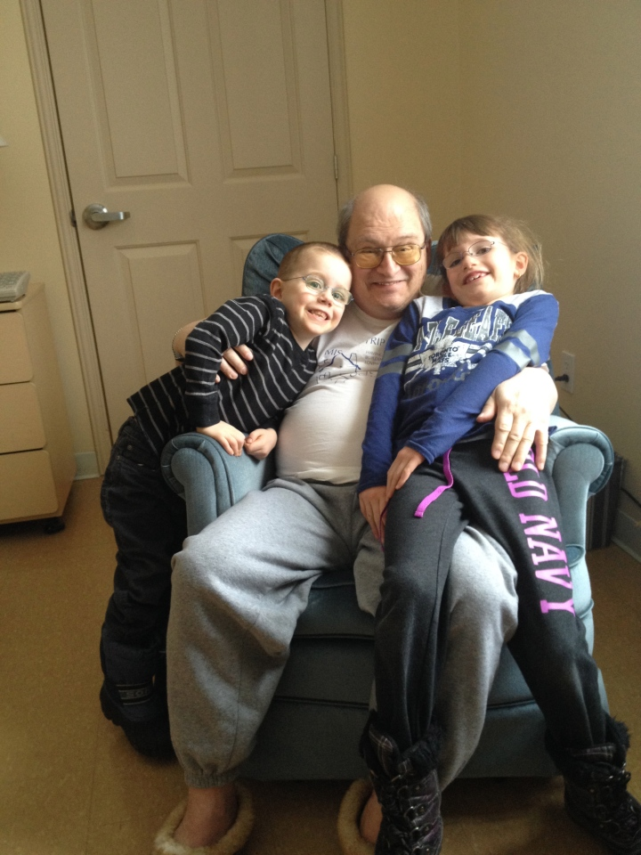 Aiden and Abby visiting with Grandpa.