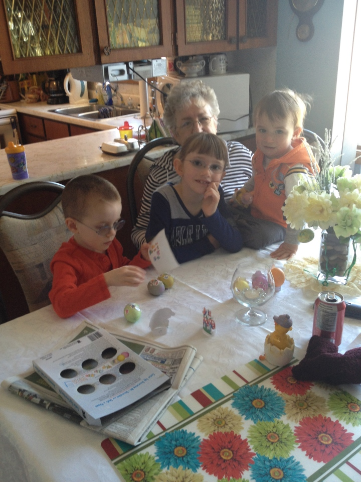 Aiden, Abby, Macklan with Mama painting eggs