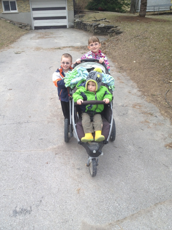 Abby and Aiden pushing Macklan to breakfast.