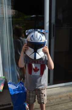 Aiden wearing Star Wars Helmet