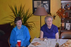 Mom with Jane visiting at the table