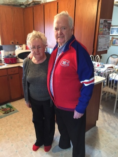 Mom with Dad showing off his new sweater