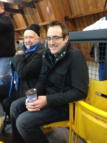 Uncle Rob and Papa watching Aiden's hockey game