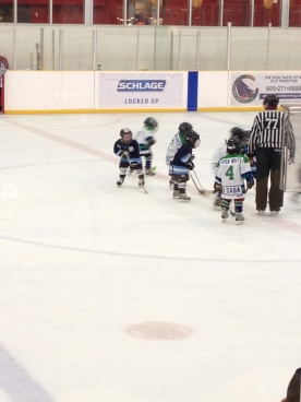 Aiden playing his hockey game