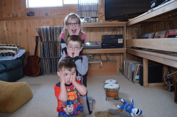 Abby, Macklan and Aiden being silly together.