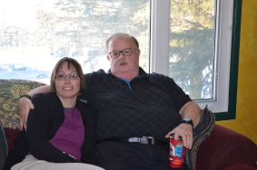 Susan and Mark relaxing on the couch.