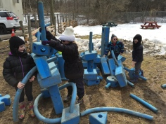 Kids building a fort at Bradley Museum Maply Syrup festival.