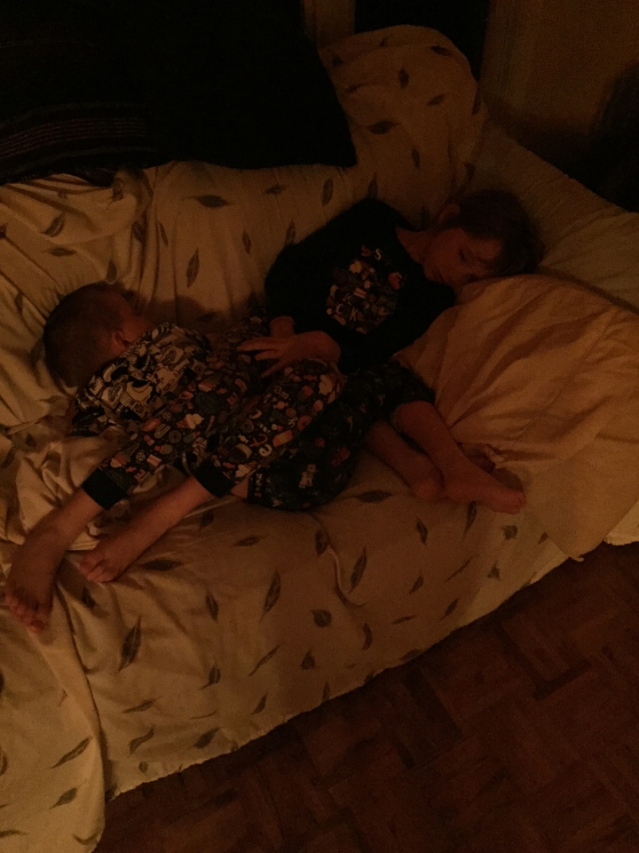 Abby and Aiden sleeping together at the Allison's on Father's Day weekend 2015.