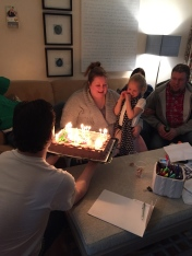 Megan blowing out the candles on her cake.