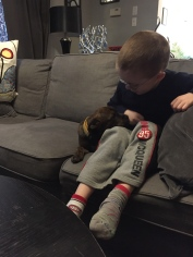 Marley hanging out with Aiden on the couch.