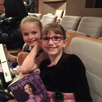 Ava and Abby at their seats at the Alice in Wonderland Ballet.