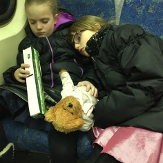 Ava and Abby sleeping on the GO Train on the way home from the Ballet.