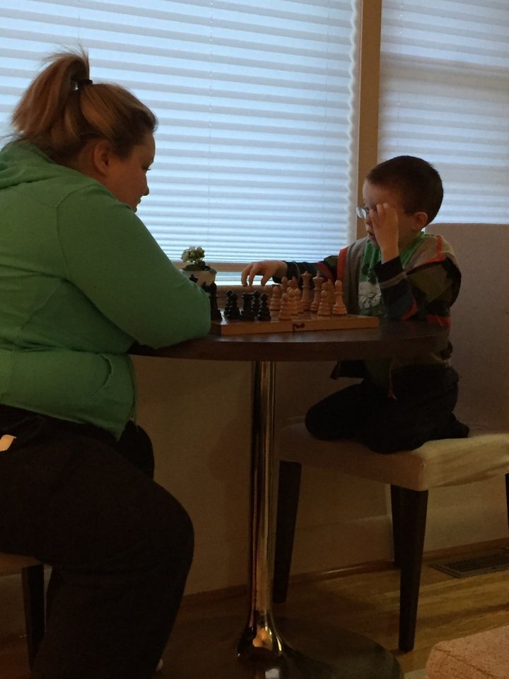 Aiden playing a game of chess with Auntie Megan on easter morning.