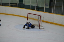 Abby stopping a shot when she played goalie. She got a shutout.