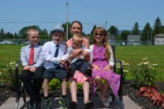 L-R: Colton, Aiden, Sage with Jasper on her lap, and Abby at the Christening