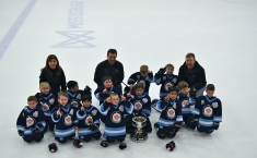 Aiden's team with consolation cup after their overtime win.