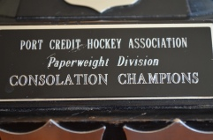 The engraving on Aiden's consolation trophy.