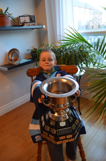 Aiden with his consolation trophy.