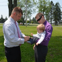 Jasper getting some last minute alterations from Dad and Christian before the Christening.