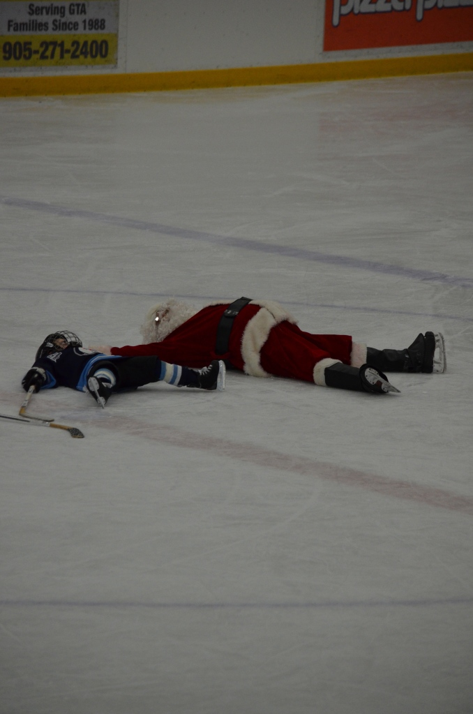 Aiden with Santa making snow angels.