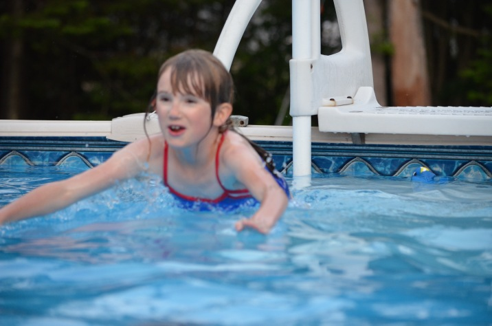 Abby jumping into the pool