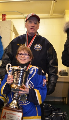 Abby with with Coach Al and her gold medal trophy.