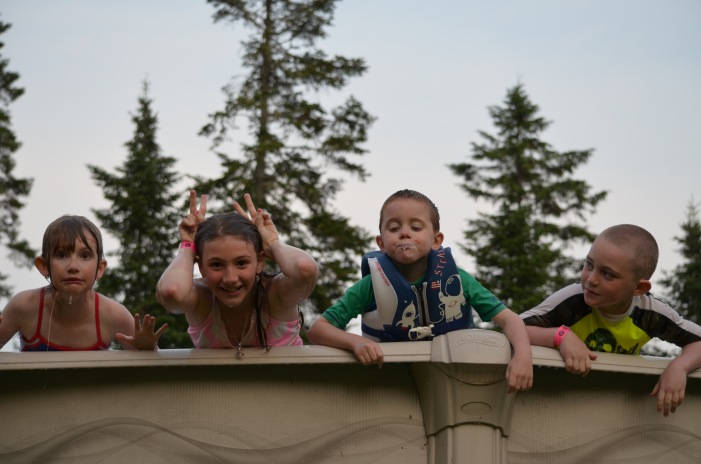 L-R: Abby, Sage, Aiden and Colton in the pool.