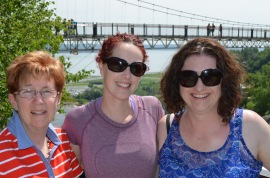 Cathy, Holly and Melissa in front of bridge at Montmorency Falls.