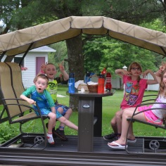 Aiden, Colton, Abby, and Sage being silly in Auntie Cathy's backyard.