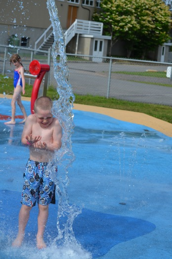 Colton playing at the Splash Pad