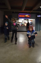 Abby, Aiden, and Macklan racing in the lobby at the Steelhead Game.