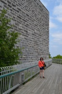 Melissa walking on boardwalk in front of Citadel