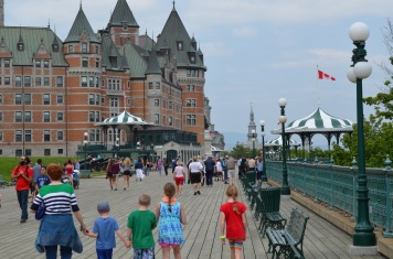 Cathy, Aiden, Colton, Sage and Abby walking on boardwalk towards Chateau Frontenac