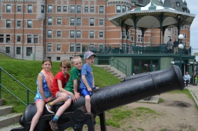Sage, Abby, Colton, and Aiden on a Canon in front of Chateau Frontenac
