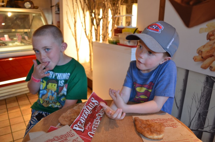Colton and Aiden eating beavertails.