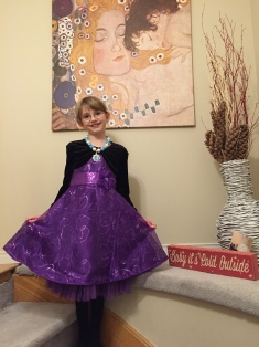 Abby with her dress for the party.