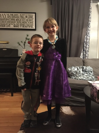 Abby and Aiden with their outfits for the party.