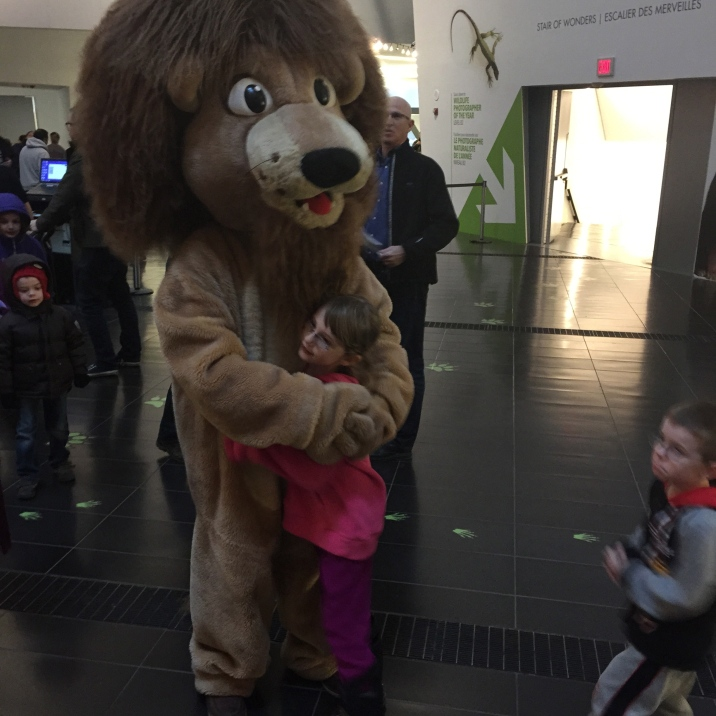 Abby hugging the lion at the ROM.