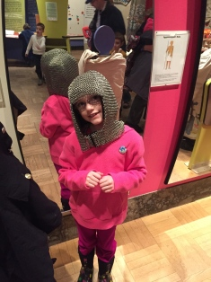 Abby wearing a chain mail helmet.