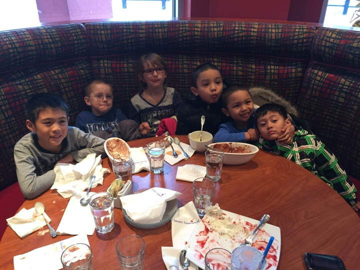 Andre, Aiden, Abby, Anthony, Jayden and Miles eating ice cream celebrating their championship year.