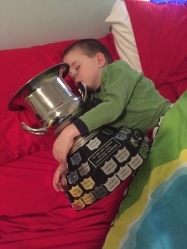 Aiden sleeping with the consolation cup.