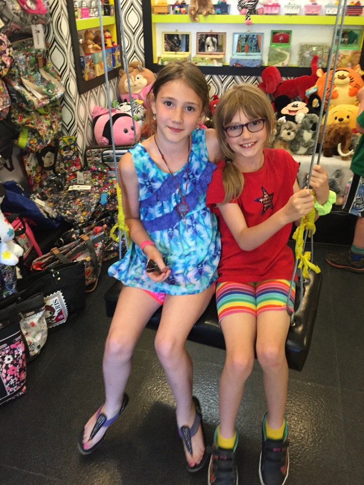 Sage and Abby shopping at a store