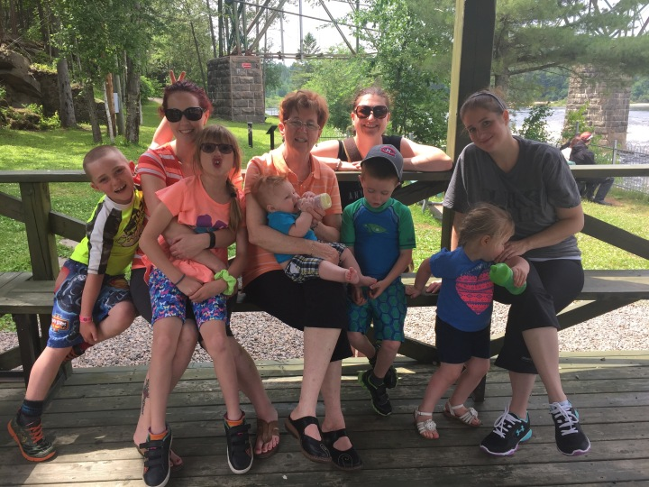 Colton, Holly with Abby on her lap, Cathy with Jake, Melissa, Aiden Ella and Sarah at Jacque Cartier river.
