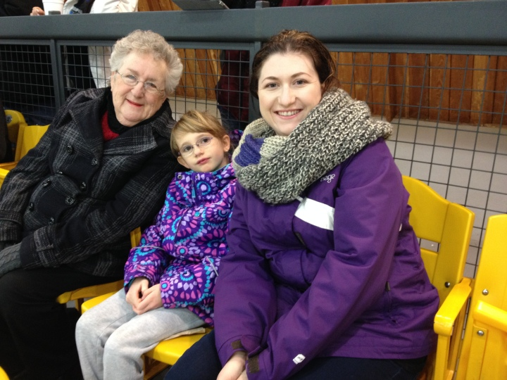 Mama, Abby and Melissa cheering Aiden on at an early morning game at Port Credit Arena.