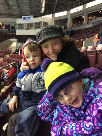 Aunt Julie, Macklan and Abigail waiting for Aiden to come on the ice.