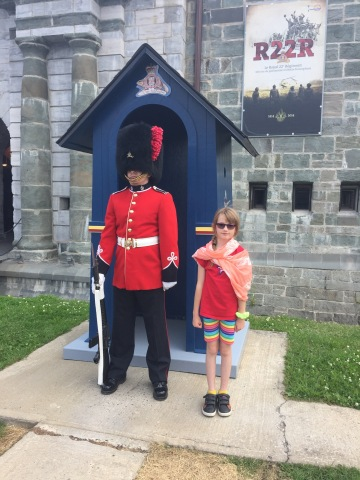 Abby with guard in front of Citadel